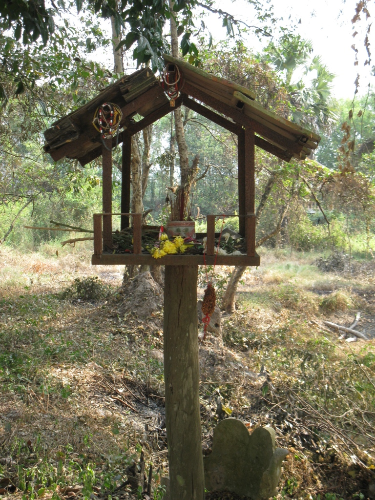 spirit house, a tradition which predates both Hinduism and Buddhism in Cambodia — meant to provide shelter for spirits who have no place to rest